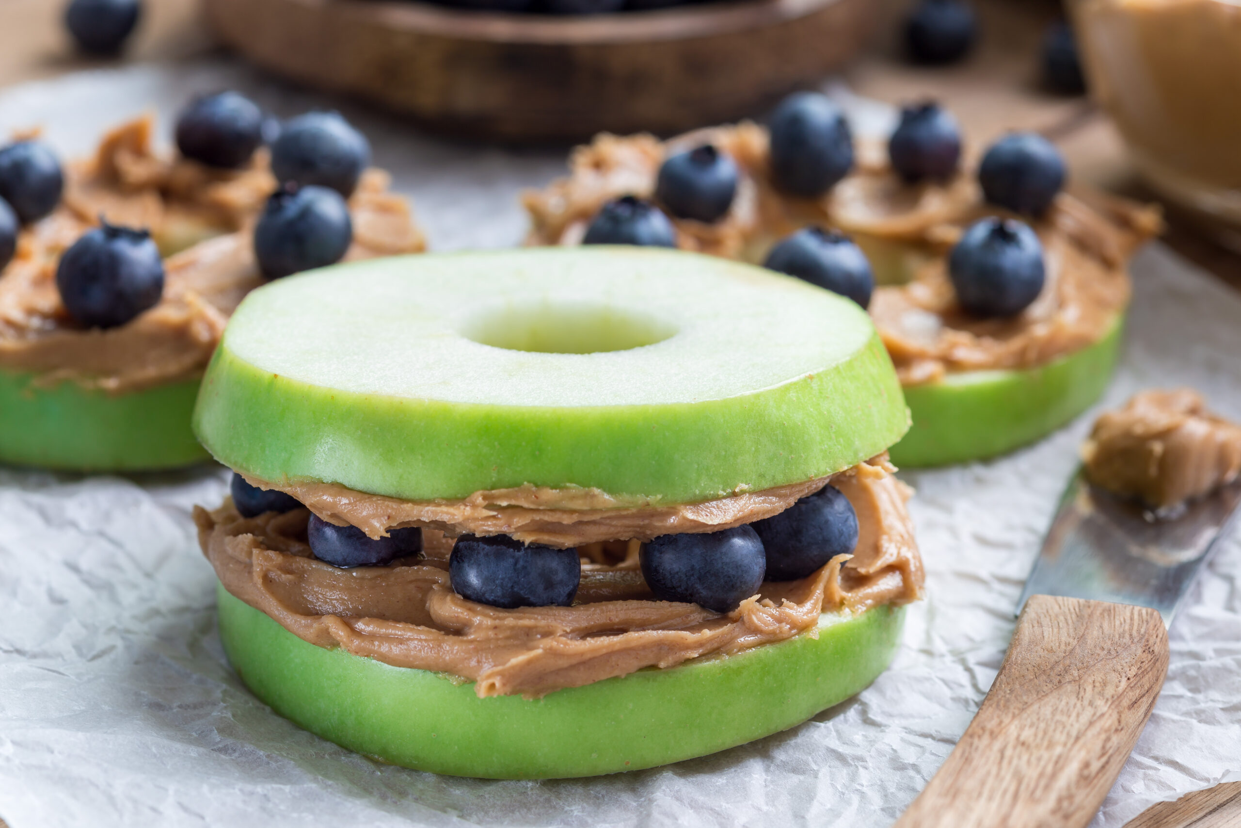 "peanut free snack ""sandwhich"" made with apple, blueberries, and almond butter."