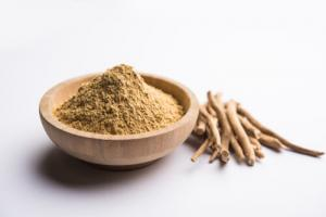 Stems and a bowl of powdered ashwagandha- a calming food to consume.