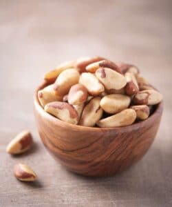 Bowl of Brazil nuts for a protein snack.